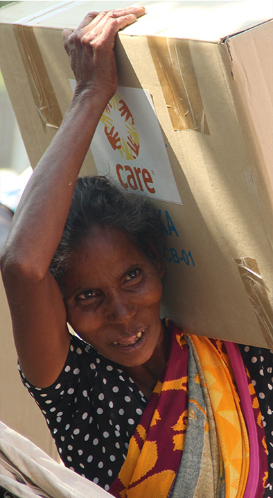 Happy Women with CARE India's Disaster Relief Kit