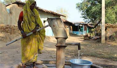 Woman Drawing Water From Hand Pump under Where The Rain Falls Project (WTRF) - CARE India