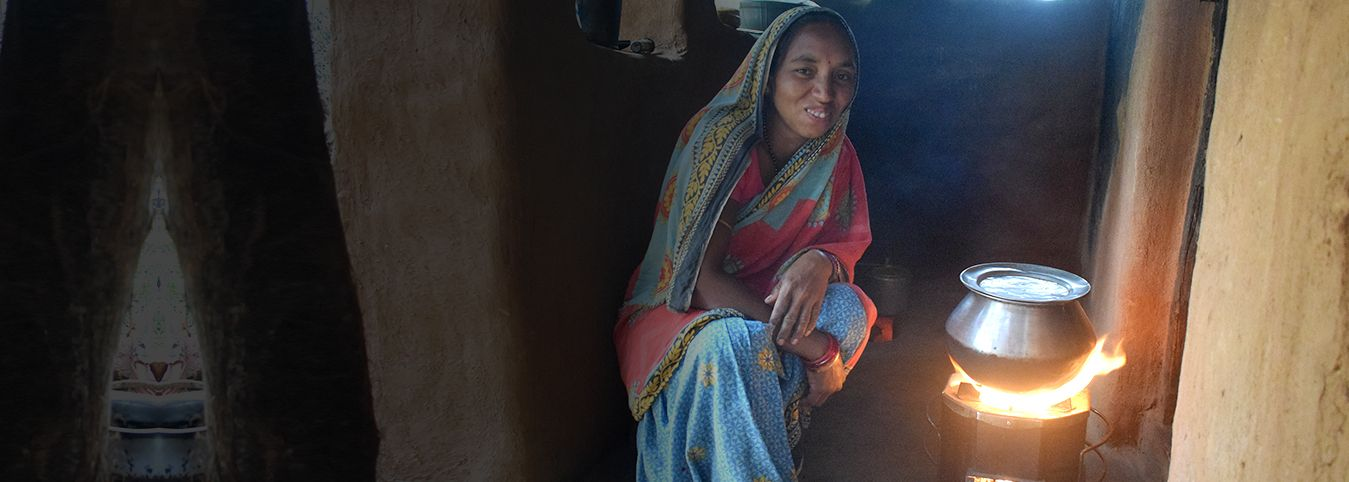 Women Cooking on Improved Cook Stoves under SWITCH ASIA Program - CARE India