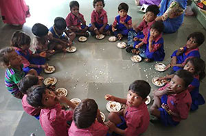 School Children Eating Under Govt. Supported Child Development Scheme (ICDS) Initiatives Supported by CARE India